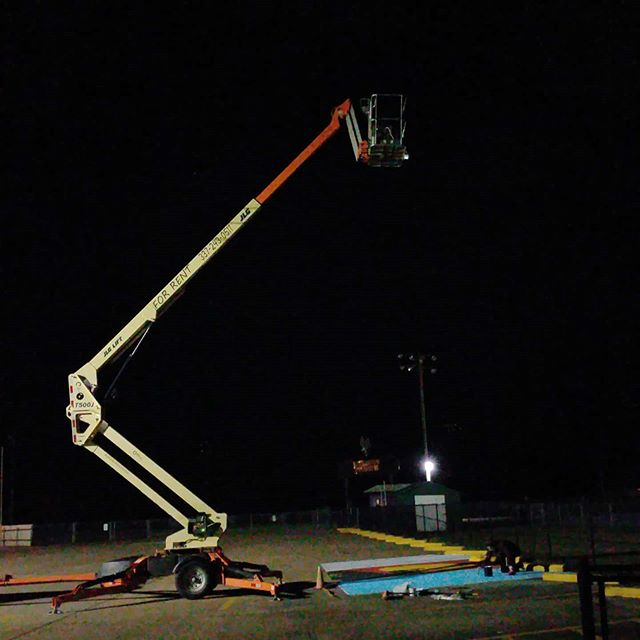 Using the man lift to paint a parking spot  That's perfect most unique application of the manlift yet! A generator and a movie projector are in the basket about 40 ft overhead. The projection of the image is on the parking space and easily able to paint.  #deridder #manlift #boomlift #deridderrentals  #leesville #fortpolk